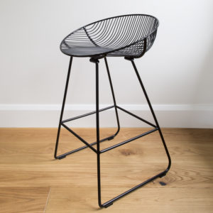 Black wire barstool with a rounded wire seat, by Ico Traders