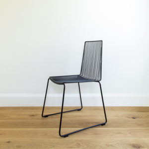 Angle view of Black metal wire dining chair. Outdoor furniture. Devonport chair by Ico Traders.