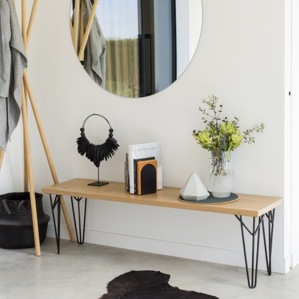 Solid oak bench seat with black hairpin legs, black curved minimalist JAMB bookends