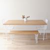Solid Oak dining table & bench seat with white hairpin legs and white wire dining chairs