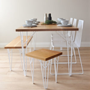Wire Furniture. Oak table and Wakatipu Bench Seat - oak bench with hairpin legs, and white wire dining chairs