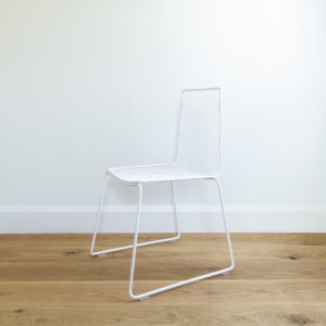 Angle view of white metal wire dining chair. Outdoor wire furniture. Devonport chair by Ico Traders