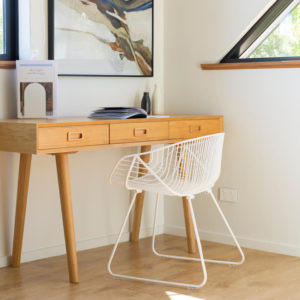 Wire furniture. Portobello Chair - a rounded white wire chair, sitting at an oak desk