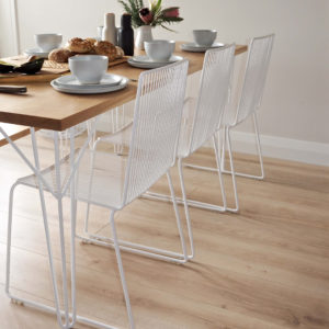 Mid century style white wire dining chairs, oak table with white hairpin legs.