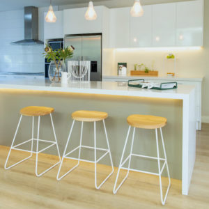 Wire furniture. Wire & Oak kitchen barstools sit at a kitchen bench