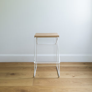 front shot of white wire kitchen stool with criss cross legs & solid oak seat
