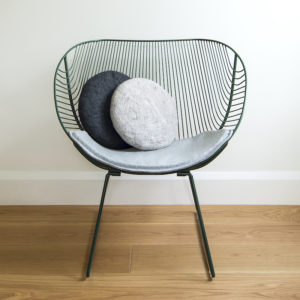 Felted wool round cushions on a wool chairpad for the Coromandel wire chair