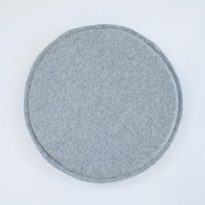 A grey, felted wool, round circle chair or stool pad / cushion