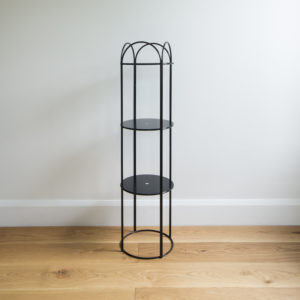 Round, three layered metal plant stand in colour black.