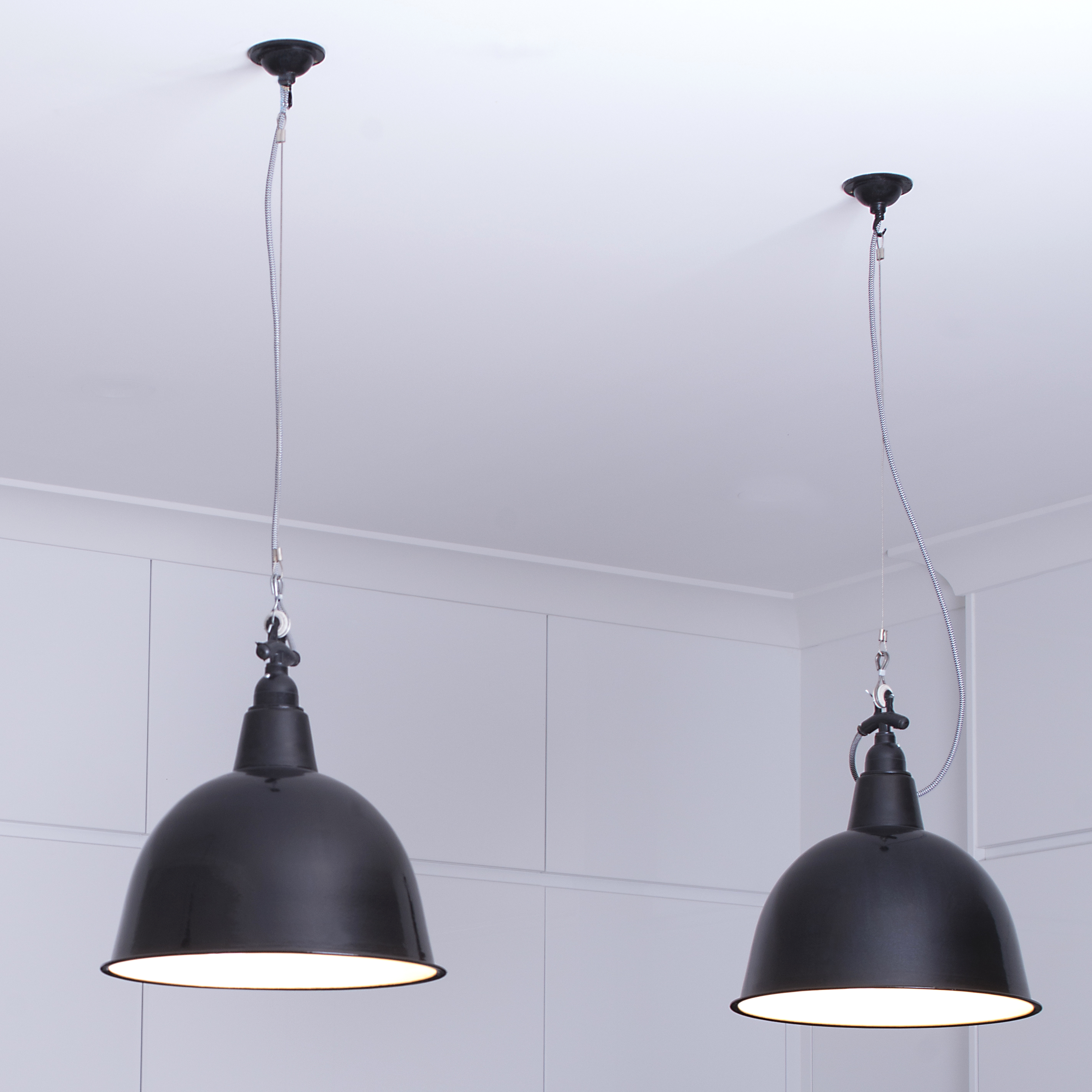 Hanging enamel lightshades, vintage industrial style lighting.