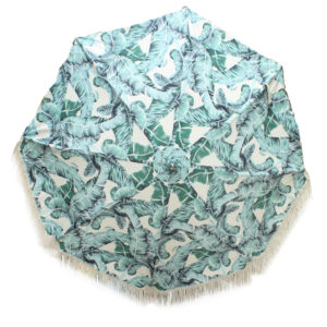 Botanical print sun umbrella with vintage cotton fringing.