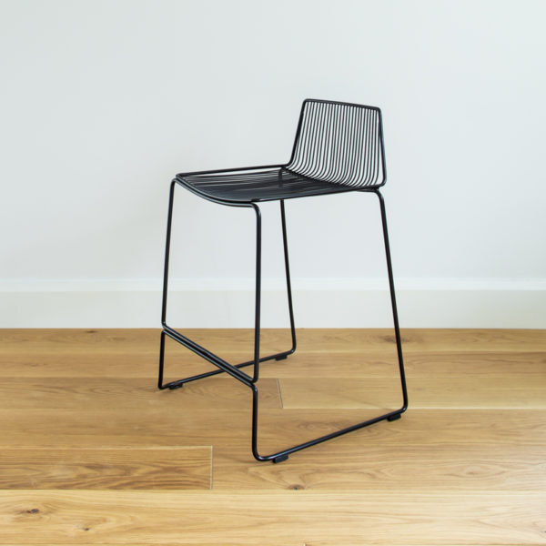 Stackable black wire barstool with a wire back. Dunedin barstool designed by Ico Traders