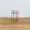 Red metal plant stand. Mahoe planter by Ico Traders
