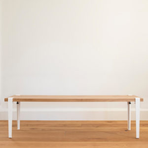 Oak bench seat with White tiptoe legs.