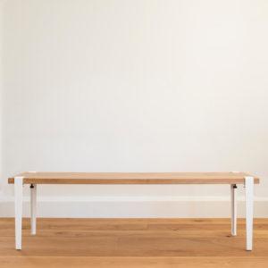 Oak bench seat with White tiptoe legs.