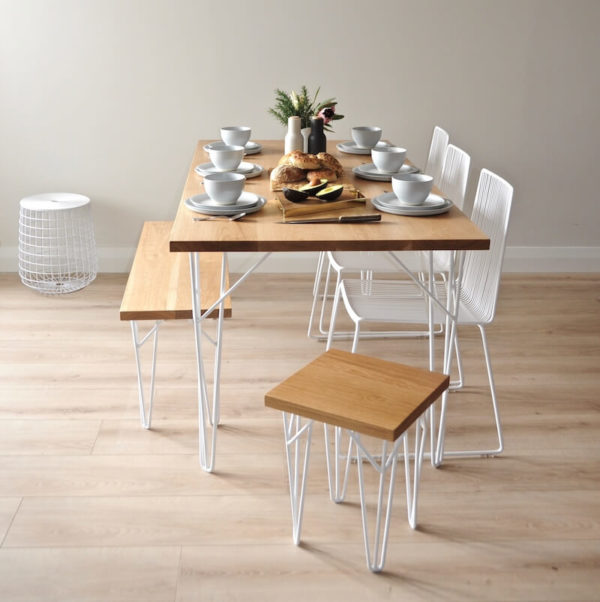 Solid Oak dining table with white hairpin legs, white wire chairs, benchseat with hairpin legs
